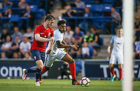 Chuba Akpom (Arsenal) of England heads forward during the International EURO U21 QUALIFYING - GROUP 9 match between England U21 and Norway U21 at the Weston Homes Community Stadium, Colchester, England on 6 September 2016. Photo by Andy Rowland / PRiME Media Images.