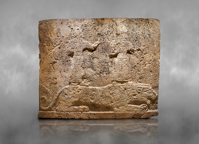 Hittite relief sculpted orthostat stone panel of Long Wall Limestone, Karkamıs, (Kargamıs), Carchemish (Karkemish), 900-700 B.C. Anatolian Civilisations Museum, Ankara, Turkey<br /> <br /> Two figures lying over the lion. There is a crescent at the head of the winged god at the front. It is thought that the figure at the front is moon god and the one at the rear is sun god. <br /> <br /> On a grey art background.