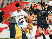 COLLEGE PARK, MD - NOVEMBER 03: Eric Matzelevich #15 of Maryland watches Mohammed Zakyi #9 of Michigan move the ball away during a game between Michigan and Maryland at Ludwig Field on November 03, 2019 in College Park, Maryland.