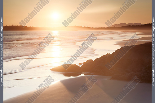 Beautiful sunset scenery of Pacific Rim National Park beach at Green Point with the soft glow of the sun. Pacific ocean shore in Tofino, Vancouver Island, BC, Canada. Image © MaximImages, License at https://www.maximimages.com