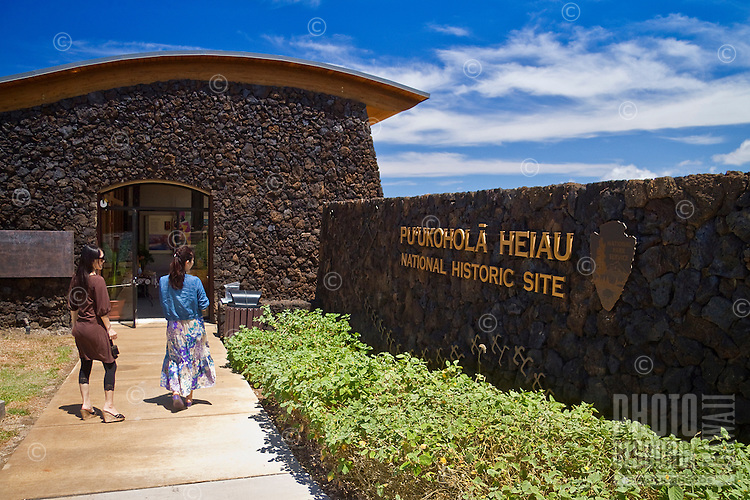 Two visitors entering the visitor center at Pu'ukohola Heiau National Historic Site, Kawaihae, Kohala, Big Island.