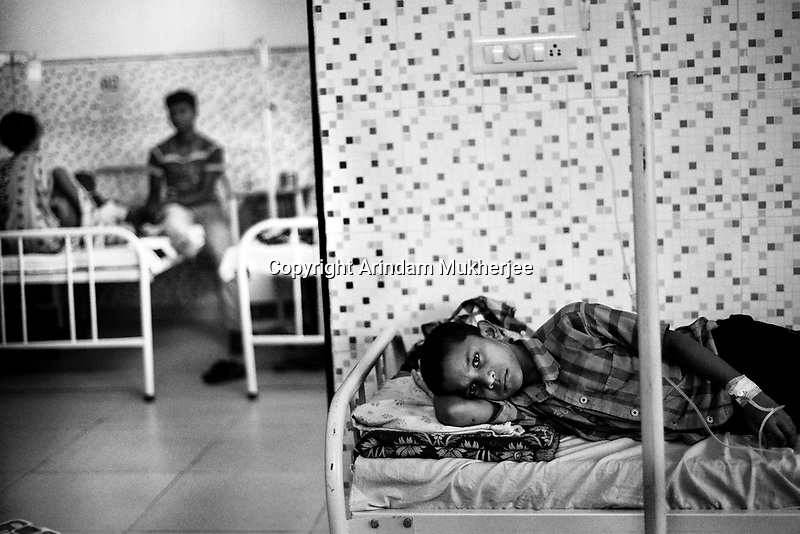 Nikesh Kashyap(9 years) a student of Sukma Football Academy is admitted to the newly built hospital. Medical facilities are made available to the students free of cost.   Sukma, Chattisgarh, India. Arindam Mukherjee