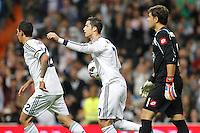 ATENCAO EDITOR IMAGENS EMBAGADAS PARA VEICULOS INTERNACIONAIS - <br /> MADRI, ESPANHA, 30 SETEMBRO 2012 - CAMP. ESPANHOL - REAL MADRID X DEPORTIVO LA CORUNA - Cristiano Ronaldo jogador do Real Madrid, comemora seu gol de penalti durante lance de partida contra Deportivo La Coruna pela sexta rodada do Campeonato Espanhol no Estadio Santiago Bernabeu em Madri capital da Espanha, neste domingo, 30. (FOTO: ALFAQUI / BRAZIL PHOTO PRESS).