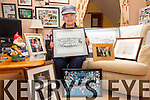 Kathleen O'Sullivan from Cahersiveen is in the final preparations for her opening of 'My South Kerry GAA Gallery' in the Upper Deck on the 23rd of January, pictured here with some of the images to feature in the exhibition.