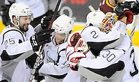 San Antonio Rampage players Colby Robak (from left), Mark Cullen, Michael Caruso and Jacob Markstrom celebrate the win after an AHL playoff hockey game against the Chicago Wolves, Saturday, April 21, 2012, in San Antonio. San Antonio won 4-3. (Darren Abate/pressphotointl.com)