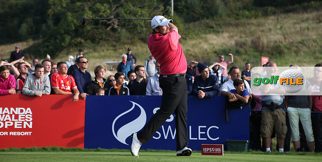 Shane Lowry (IRL) drives to the centre of the fairway on the last  during Round Three of the ISPS Handa Wales Open 2014 from the Celtic Manor Resort, Newport, South Wales. Picture:  David Lloyd / www.golffile.ie