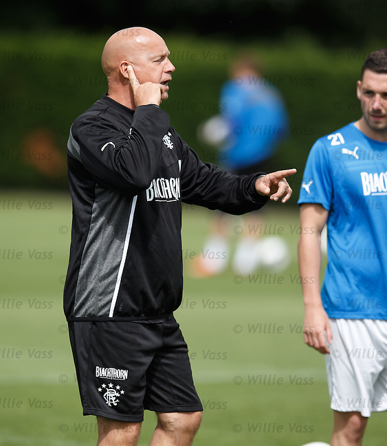Kenny McDowall phones a friend and says that the gaffer is out