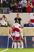 Kenny Cooper (33) of the New York Red Bulls celebrates scoring with teammates  during the first half against Toronto FC . The New York Red Bulls defeated Toronto FC 4-1 during a Major League Soccer (MLS) match at Red Bull Arena in Harrison, NJ, on September 29, 2012.