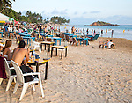 People sitting at tables of beach bar, Mirissa, Sri Lanka, Asia