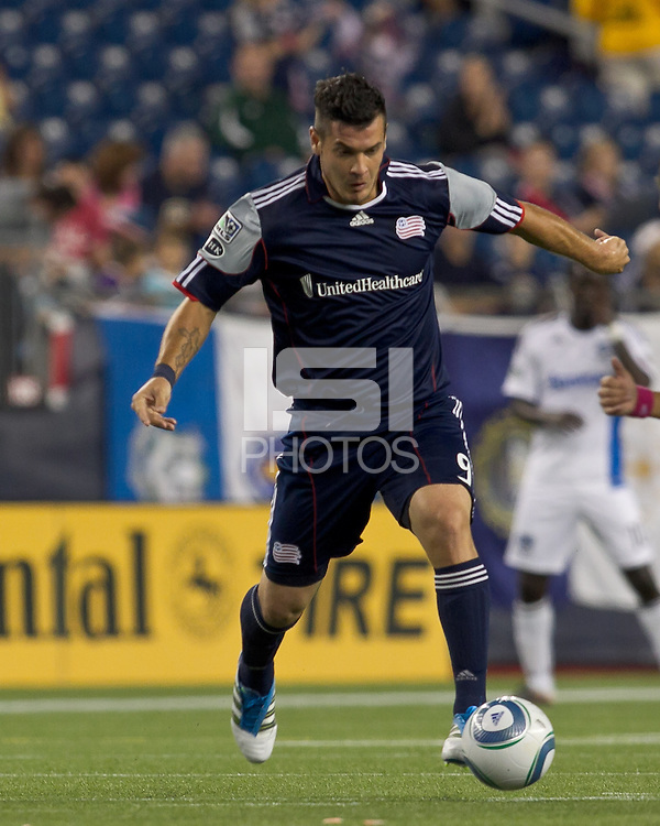 New England Revolution forward Milton Caraglio (9) on the attack. In a Major League Soccer (MLS) match, the San Jose Earthquakes defeated the New England Revolution, 2-1, at Gillette Stadium on October 8, 2011.