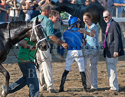 Eddie Castro's OK; he laughs -- and prepares to get back on It's Tricky for walk into winner's circle.