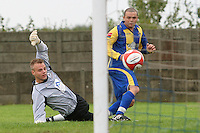 Toran Senghore rounds Beaconsfield goalkeeper Carl Dennison to score his side's third goal - Romford vs Beaconsfield SYCOB - FA Cup Preliminary Round Football at Mill Field, Aveley FC - 29/08/10 - MANDATORY CREDIT: Gavin Ellis/TGSPHOTO - SELF-BILLING APPLIES WHERE APPROPRIATE. NO UNPAID USE. TEL: 0845 094 6026
