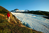 A visitor (MR) view the Worthington glacier at the Worthington Glacier State Recreation Site in the Chugach Mountains and Chugach National Forest is viewable from the Richardson Highway as the highway passes over Thompson Pass on the way to Valdez, Alaska.