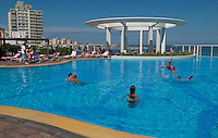 Families play in the rooftop pool at the Conrad Resort and Casino in Punta del Este, Uruguay. The venerable South American beach resort is having a rennaisance. (Kevin Moloney for the New York Times)