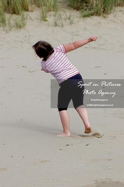 A girl dances on the beach