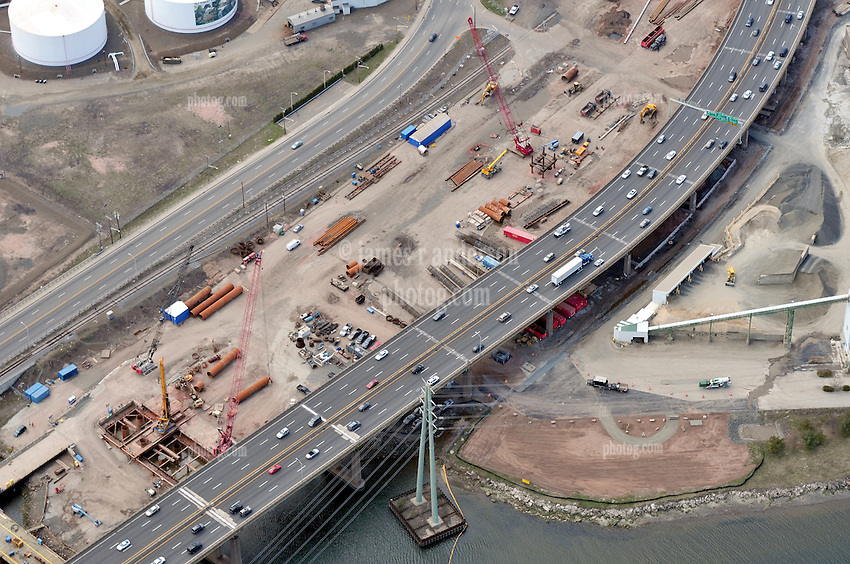 "Early Eastbound Approach Construction Contract B1, Pearl Harbor Memorial ""Q"" Bridge, just east of Interstate I-95 I-91 CT Route 34 Interchanges. Surface road Water Street/Forbes Avenue at left. Details of approaches, overpasses, ramps & roadway near or within I-95 New Haven Harbor Crossing Corridor projects confines. Photography taken at the beginning of Contract B1 & E1"
