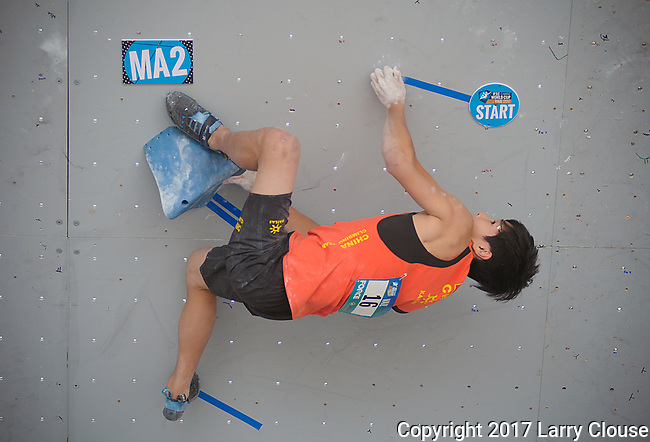 June 9, 2017 - Vail, Colorado, U.S. - China's, Yufei Pan #16, works through his first climbing problem in the IFSC Climbing World Cup during the GoPro Mountain Games, Vail, Colorado.  Adventure athletes from around the world meet in Vail, Colorado, June 8-11, for America's largest celebration of mountain sports, music, and lifestyle.