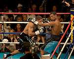 Sugar Shane Mosley of Pomona, California, mixes it up with WBC/WBA super welterweight champion Winky Wright of St. Petersburg, Florida, Wright wins majority decision
