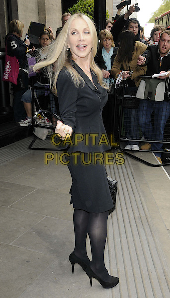 Singer / songwriter Lynsey De Paul has died at the age 64 following suspected brain haemorrhage. She represented the UK in the 1977 Eurovision Song Contest and was best known for her hits Sugar Me and Won't Somebody Dance With Me.<br /> STOCK PHOTO: Lynsey De Paul<br /> The Ivor Novello Awards 2012, Grosvenor House Hotel, Park Lane, London, England.<br /> May 17th, 2012<br /> full length black skirt jacket hand arm side <br /> CAP/CAN<br /> &copy;Can Nguyen/Capital Pictures