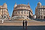 Piazza de Ferrari with a large fountain in the middle and Palazzo della Nuova Borsa across the way