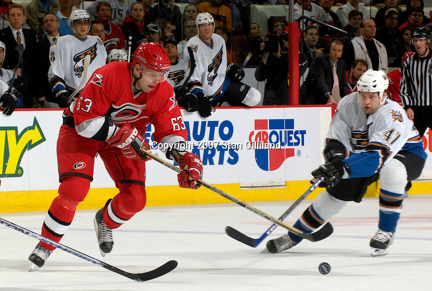 Carolina Hurricanes' Josef Vasicek tries to move past the Washington Capitals' Bryan Muir Thursday, March 22, 2007 at the RBC Center in Raleigh, NC. Carolina won 4-3.