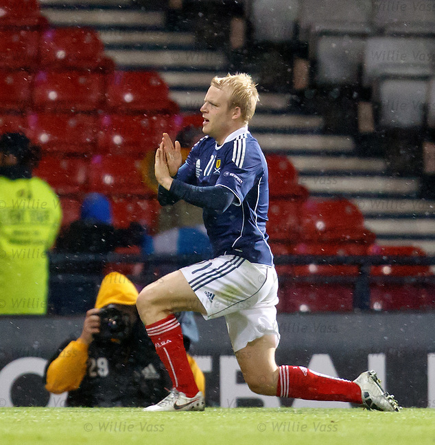 Steven Naismith celebrates his goal for Scotland withy his trademark X-hands celebration