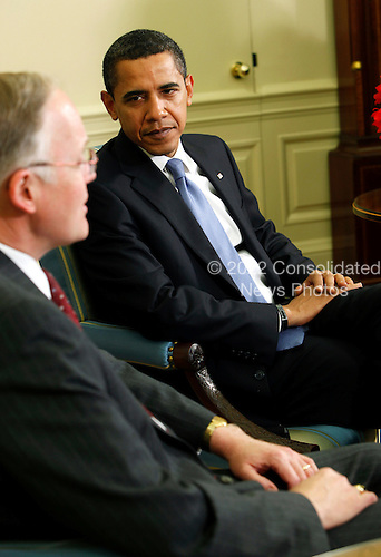 Washington, DC - February 2, 2009 -- United States President Barack Obama listens to Jim Douglas, Governor of Vermont discuss the economy in the Oval Office of the White House, Washington DC, February 2, 2009..Credit: Aude Guerrucci - Pool via CNP