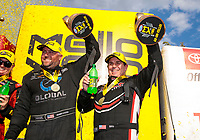 Sep 29, 2019; Madison, IL, USA; NHRA funny car driver Shawn Langdon (left) and top fuel driver Billy Torrence celebrate after winning the Midwest Nationals at World Wide Technology Raceway. Mandatory Credit: Mark J. Rebilas-USA TODAY Sports