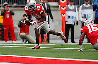 Ohio State Buckeyes cornerback Eli Apple (13) recovers a fumble and runs for a touchdown in the second quarter of an NCAA college football game between The Ohio State Buckeyes and the Rutgers Scarlet Knights at Ohio Stadium on Saturday, October 18, 2014.  (Columbus Dispatch photo by Fred Squillante)