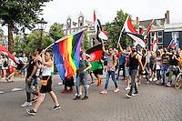 Nederland Amsterdam 2016 07 23 .  Amsterdam Europride 2016. EuroPride 2016 begint met Roze Zaterdag. Pride Walk door de stad. Vlaggenparade. Foto mag niet in negatieve context gebruikt worden. Foto Berlinda van Dam / Hollandse Hoogte