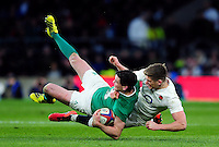 Jonathan Sexton of Ireland is tackled to ground by Owen Farrell of England. RBS Six Nations match between England and Ireland on February 27, 2016 at Twickenham Stadium in London, England. Photo by: Patrick Khachfe / Onside Images