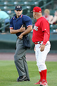 June 20th 2008:  NY-Penn League umpire Joey Amaral explains a call to Mark DeJohn of the Batavia Muckdogs during a game at Frontier Field in Rochester, NY - home of the Rochester Red Wings.  Photo by:  Mike Janes/Four Seam Images