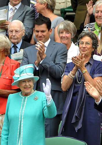 The queen at Wimbledon waves to the crowd cheered on by Tim Henman and former singles champ Virginia Wade. Queen Elizabeth II arrived at Wimbledon on Thursday for her first visit to the All England Club since 1977, The Queen visits Wimbledon for the first time in 33 years.Wimbledon Lawn Tennis Championships at the All England Lawn Tennis and Croquet Club on June 23, 2010 in London, England.