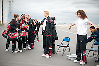 SAN JOSE, CA--Freshmen Taylor Greenfield and Erica Payne engage in the security check at Atlantic Aviation en route to Norfolk, VA for the first and second rounds of the 2012 NCAA tournament.