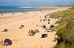 People on a wide sandy beach at Hunstanton, north Norfolk coast, England
