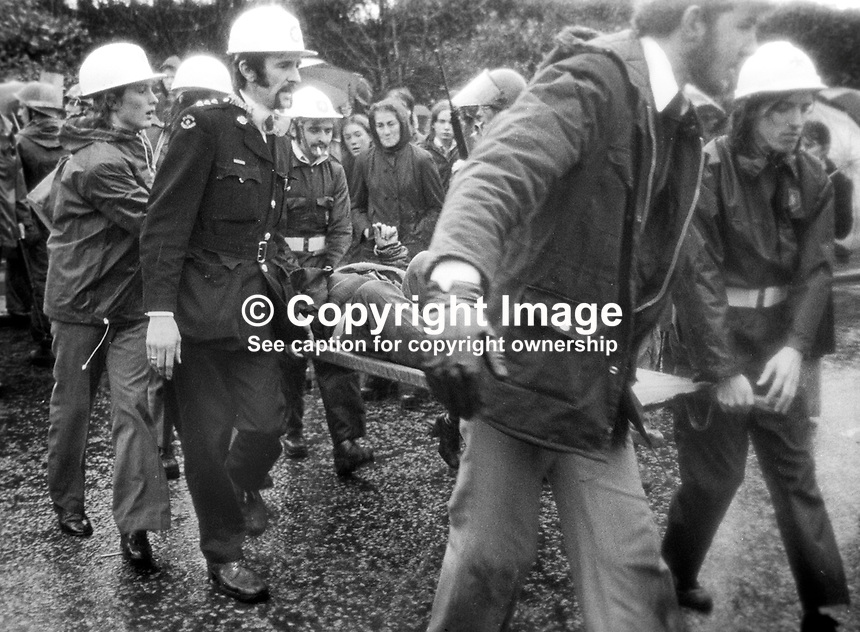Peace People March along the Falls Road, Belfast, N Ireland, UK, 23rd October 1976 - Injured Peace People marcher is stretchered to an ambulance after being hit by a missile thrown by an opponent of the Peace March. 197610230506e<br /> <br /> Copyright Image from Victor Patterson, 54 Dorchester Park, Belfast, UK, BT9 6RJ<br /> <br /> t: +44 28 9066 1296<br /> m: +44 7802 353836<br /> <br /> e1: victorpatterson@me.com<br /> e2: victorpatterson@gmail.com<br /> <br /> IMPORTANT: My Terms and Conditions of Business are at www.victorpatterson.com