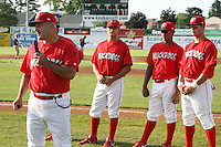 June 19, 2009:  Manager Mark DeJohn of the Batavia Muckdogs addresses the crowd as Dan Richardson, LaCurtis Mayes, and Beau Riportella listen during a ceremony to award the 2008 NY-Penn League Champions before a game at Dwyer Stadium in Batavia, NY.  The Batavia Muckdogs are the NY-Penn League Short Season Class-A affiliate of the St. Louis Cardinals.  Photo by:  Mike Janes/Four Seam Images