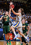 BROOKINGS, SD - JANUARY 31:  Kerri Young #10 from South Dakota State University takes the ball to the basket against Marena Whittle #32 from North Dakota State University in the first half of their game Saturday afternoon at Frost Arena in Brookings. (Photo by Dave Eggen/Inertia)