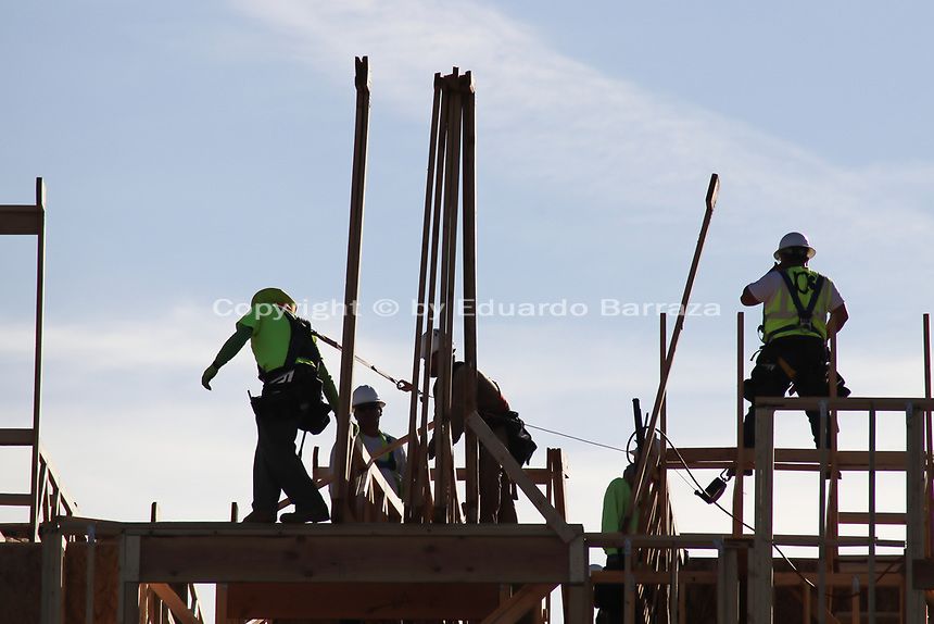 (Gilbert, Arizona) -- Wood framing workers working in a commercial site in Arizona.
