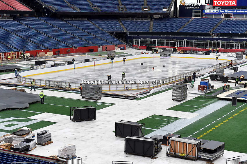 Wednesday, December 23, 2015: Work crews build an ice hockey rink on the game field at Gillette Stadium in preparation for the 2016 Bridgestone NHL Winter Classic® hockey game between the Montreal Canadiens and the Boston Bruins to be held January 1, 2016 in Foxborough, Massachusetts. Eric Canha/CSM