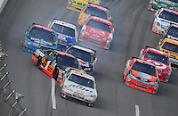 Oct 5, 2008; Talladega, AL, USA; NASCAR Sprint Cup Series driver Dale Earnhardt Jr (88) leads the field as Martin Truex Jr (1) spins after contact with Brian Vickers (83) who blew a tire during the Amp Energy 500 at the Talladega Superspeedway. Mandatory Credit: Mark J. Rebilas-
