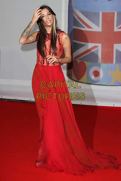Christina Perri.The Brit Awards 2012 arrivals, O2 Greenwich, London, England 21st February 2012.Brits full length red sheer dress tattoos beads beaded hand arms.CAP/ROS.©Steve Ross/Capital Pictures