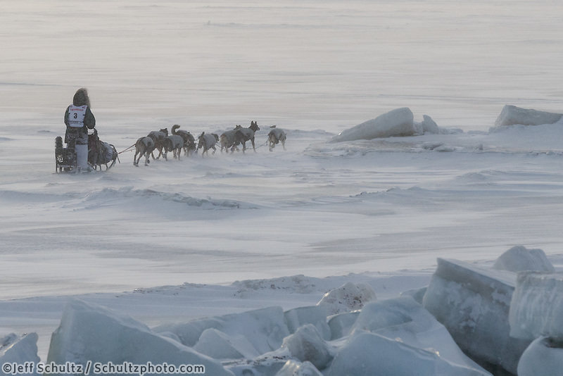 Paige Drobny runs on the Bering Sea close in to Nome on Wednesday March 12, during the 2014 Iditarod Sled Dog Race.<br /> <br /> PHOTO (c) BY JEFF SCHULTZ/IditarodPhotos.com -- REPRODUCTION PROHIBITED WITHOUT PERMISSION