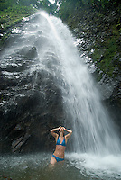 Young woman playing in watefall pool, Chiriqui Viejo River, Panama