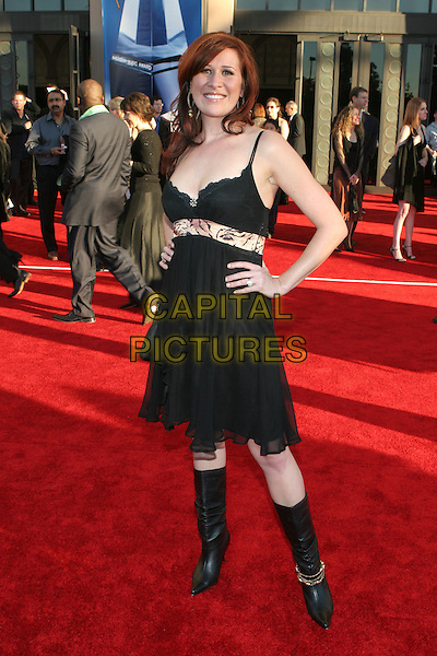 NADIA GELLER.33rd Annual American Music Awards - Arrivals held at the Shrine Auditorium. Los Angeles, California..USA, United States..22nd November 2005 .Ref:ADM/ZL.full length black strappy dress lace belt knee high boots hands on hips.www.capitalpictures.com.sales@capitalpictures.com.© Capital Pictures.