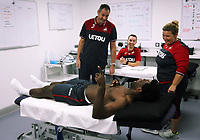 Pictured: Wilfried Bony speaks with manager Paul Clement during his medical with club physiotherapist Kate Rees at the Fairwood Training Ground, Wales, UK. Thursday 31 August 2017<br />Re: Wilfried Bony has signed a contract with Swansea City FC.
