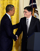 """United States President Barack Obama, left, shakes hands with White House Chief of Staff Jacob """"Jack"""" Lew, right, whom he named as Secretary of the Treasury to replace Timothy Geithner (not pictured) in the East Room of the White House in Washington, D.C. on Thursday, January 10, 2013..Credit: Ron Sachs / CNP"""