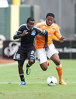 San Francisco, California - Saturday March 17, 2012: Marvin Chavez tries to control the ball away from Jermaine Taylor during the MLS match at AT&T Park. Houston Dynamo defeated San Jose Earthquakes  1-0