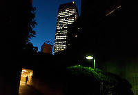 A man walks in a brightly lit passage way under Ebisu Garden Place, Ebisu, Tokyo, Japan. Friday September 27th 2013