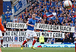 Rangers fans in BF1 unfurl a message of support for midfielder Ian Black after getting abuse from Scotland fans at Easter Road